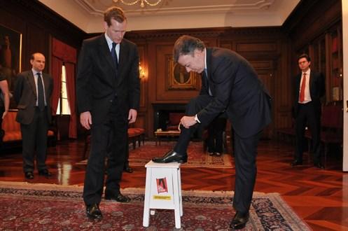 President Santos Lends His Leg